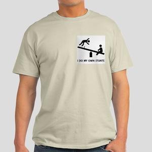 Fall off a see saw. Stunts Light T-Shirt