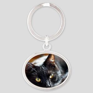 Sleek Black Cat Oval Keychain