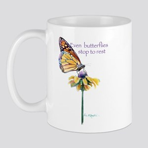 Monarch butterfly resting Mug