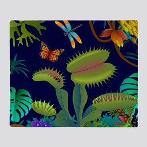 Venus fly trap in the rainforest pil Throw Blanket