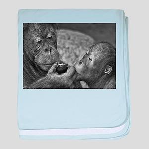 orangutans-sharing-an-apple baby blanket