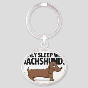 Sleep With Dachshunds Oval Keychain