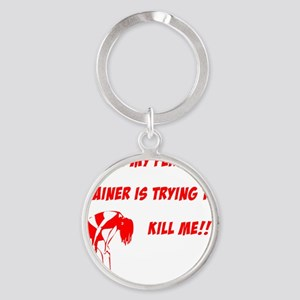 trainer is trying to kill me Round Keychain