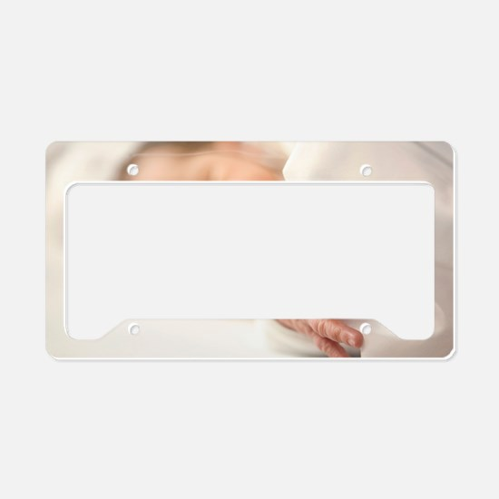 One day old baby girl sleepin License Plate Holder