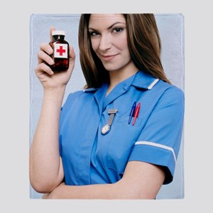 Nurse holding a bottle of pills Throw Blanket
