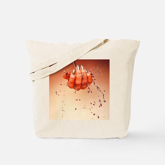 Mercury flowing through fingertips Tote Bag