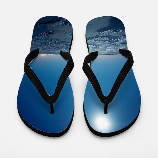 Low tide at night Flip Flops