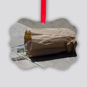 Discarded rum bottle in paper bag Picture Ornament