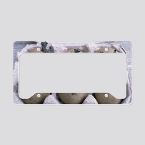 Chitted potatoes in an egg bo License Plate Holder