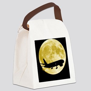 Aeroplane silhouetted against a f Canvas Lunch Bag