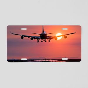 Aeroplane landing at sunset Aluminum License Plate