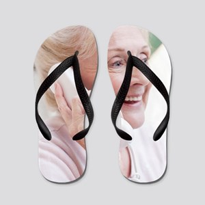 Senior woman talking on the telephone Flip Flops