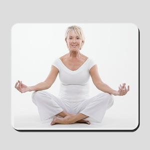 Senior woman doing yoga Mousepad