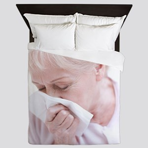 Senior woman blowing her nose Queen Duvet