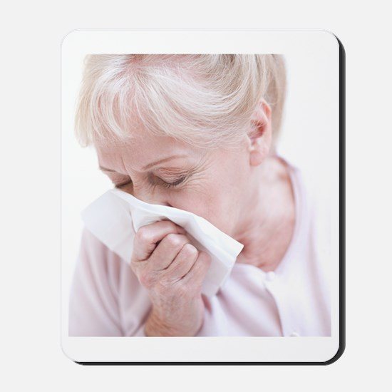 Senior woman blowing her nose Mousepad