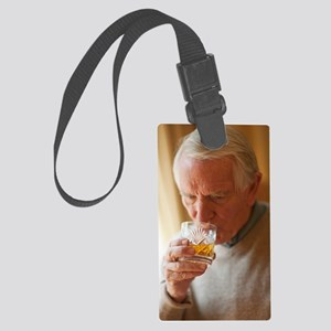 Senior man drinking whiskey Large Luggage Tag