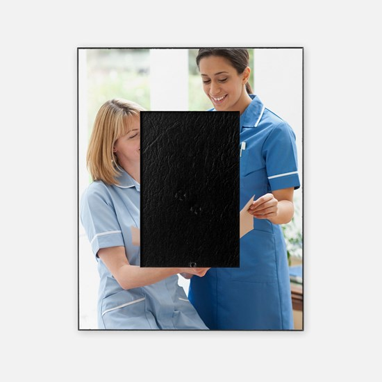 Nurses checking notes Picture Frame