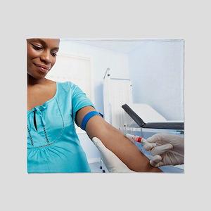 Obstetric examination Throw Blanket