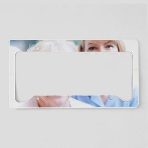 Nurse on a home visit License Plate Holder