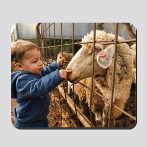 Toddler with a sheep Mousepad