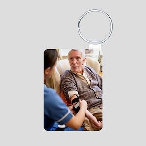 Measuring blood pressure Aluminum Photo Keychain