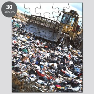 View of a bulldozer working a landfill refu Puzzle