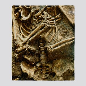 View of the skeleton of a neandertha Throw Blanket