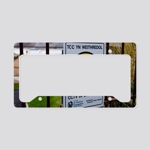 Security camera sign at a sch License Plate Holder