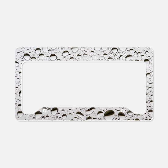 Raindrops on a window pane License Plate Holder