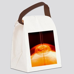 Oil being poured Canvas Lunch Bag