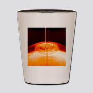 Oil being poured Shot Glass
