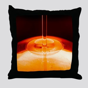 Oil being poured Throw Pillow