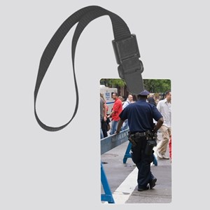 New York policeman leaning on ba Large Luggage Tag