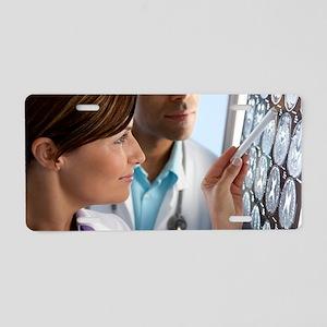 Doctors examining MRI scans Aluminum License Plate