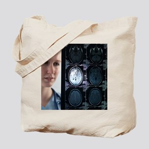 Doctor studying an MRI scan Tote Bag