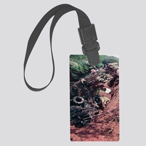 Ravine filled with rubbish Large Luggage Tag