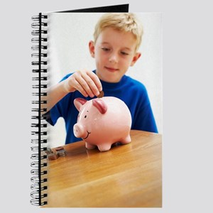 Child with a piggy bank Journal