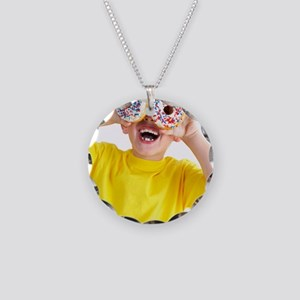 Boy playing with doughnuts Necklace Circle Charm