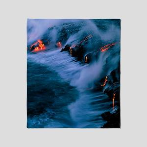 Molten lava flowing into the ocean Throw Blanket