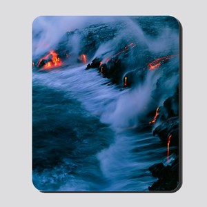 Molten lava flowing into the ocean Mousepad