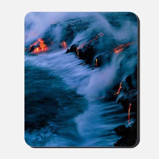 Molten lava flowing into the ocean Mousepad