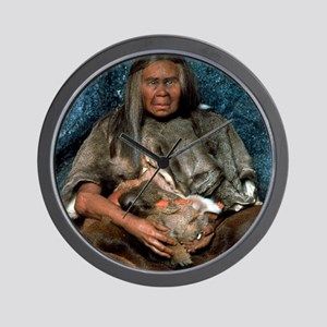 Model of a neanderthal woman holding a  Wall Clock