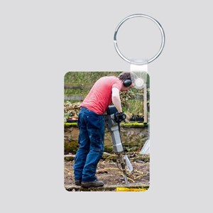 Man breaking concrete with Aluminum Photo Keychain