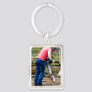 Man breaking concrete with a jac Portrait Keychain