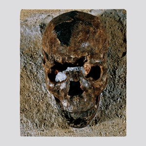 Fossilised skull of a Homo erectus b Throw Blanket
