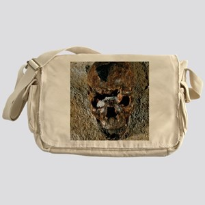 Fossilised skull of a Homo erectus b Messenger Bag