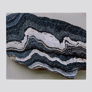 Folded strata in gneiss rock Throw Blanket