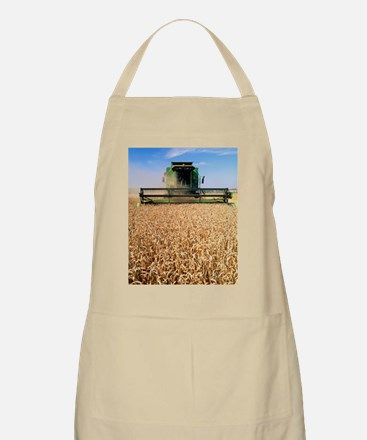 Combine harvester working in a wheat field Apron