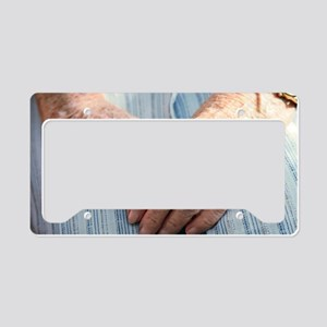 Elderly woman's hands License Plate Holder