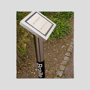 Braille sign in botanical garden Throw Blanket